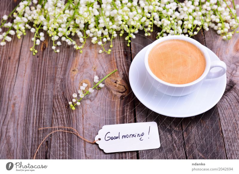 cup of coffee on a saucer White Flower Wood Brown Above Fresh Retro Table Coffee Bouquet Good Hot Breakfast Restaurant Café Crack & Rip & Tear