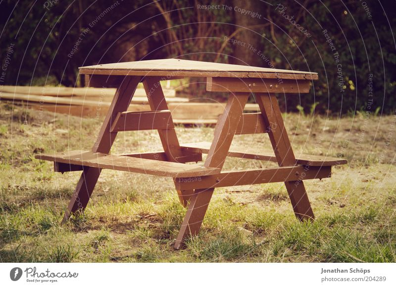 Table set you up Nature Esthetic Brown Green Calm Idyll Garden Wood Seating Bench Small Empty Unused Triangle Meadow Colour photo Exterior shot Deserted Light