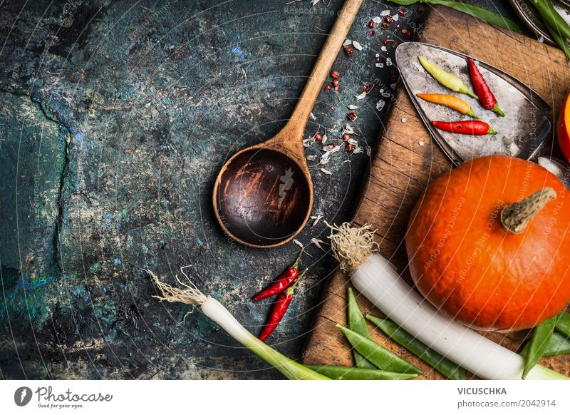 Pumpkin on kitchen table with ingredients and cooking spoon Food Vegetable Herbs and spices Nutrition Banquet Organic produce Vegetarian diet Diet Crockery