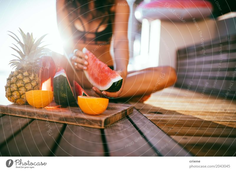 Woman eating fresh watermelon on balcony in summer Fruit Nutrition Eating Lifestyle Joy Healthy Eating Leisure and hobbies Summer Summer vacation Sun