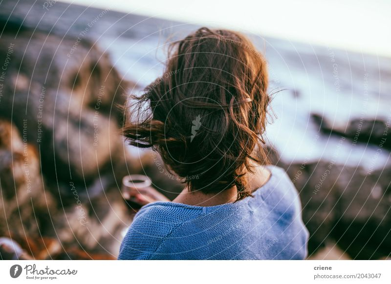 Back view of woman looking on ocean Drinking Lifestyle Beach Ocean Waves Human being Feminine Young woman Youth (Young adults) Woman Adults Hair and hairstyles