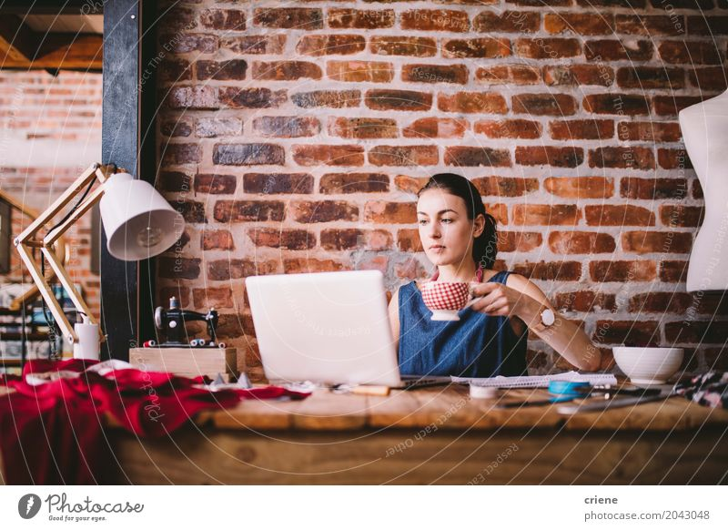 Young businesswoman working on laptop and drinking coffee Human being Woman Youth (Young adults) Young woman 18 - 30 years Adults Lifestyle Feminine Business