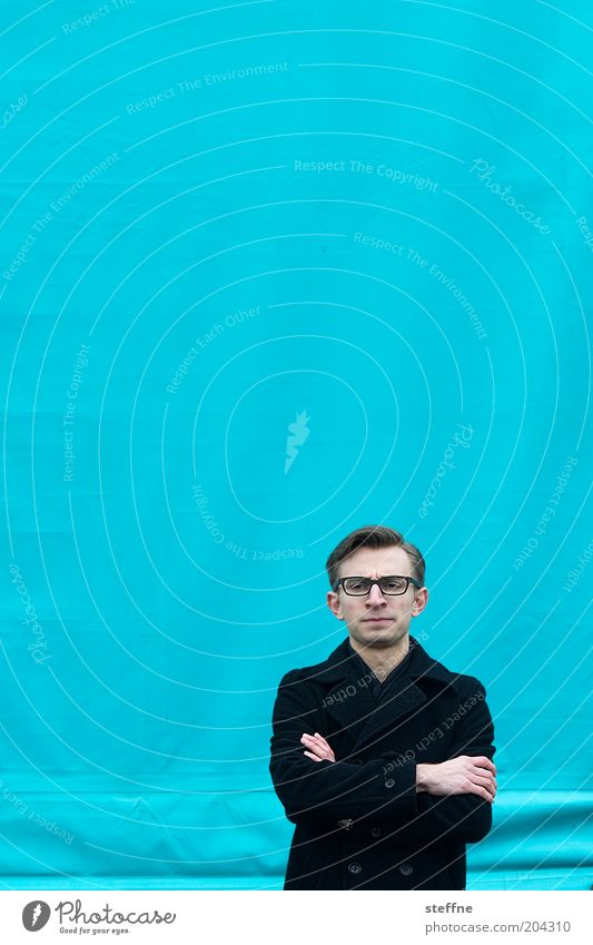 Human being Youth (Young adults) Blue Think Adults Masculine Closed Communicate Eyeglasses Portrait photograph Coat Man Gesture Skeptical Interlocked Dismissive