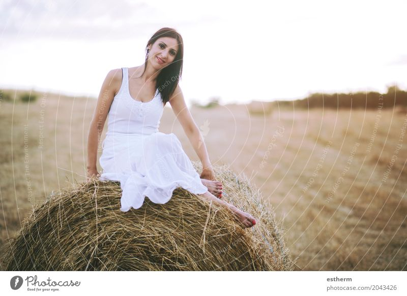 Smiling girl sitting on the straw Human being Woman Youth (Young adults) Young woman Landscape Joy Adults Lifestyle Love Meadow Healthy Feminine Style Fashion Field Elegant