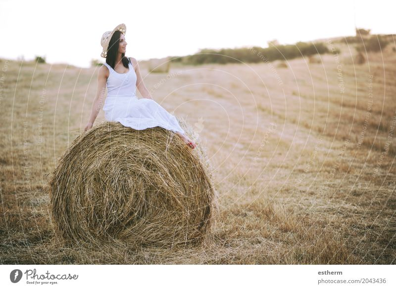 Smiling girl sitting on the straw Human being Woman Nature Youth (Young adults) Young woman Summer Beautiful Landscape Joy Adults Lifestyle Emotions Meadow