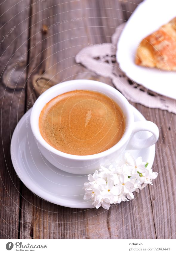 Black coffee in a white cup Croissant Dessert Breakfast Coffee Espresso Mug Table Restaurant Flower Bouquet Wood Eating Fresh Hot Above Retro Brown Gray White
