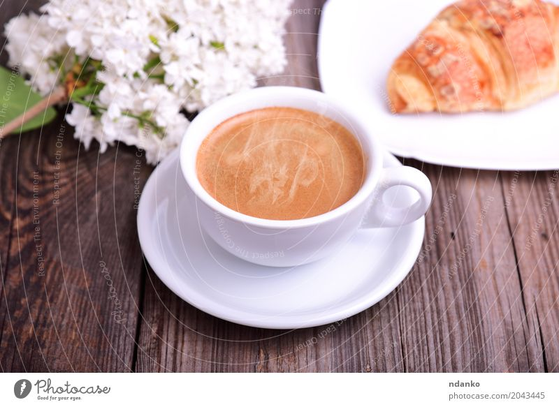 Cup of hot black coffee with croissant Croissant Breakfast Coffee Espresso Table Restaurant Flower Bouquet Wood Fresh Hot Delicious Above Retro Brown White Café
