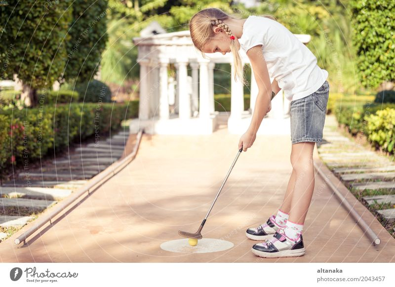 Little girl swinging mini golf club Lifestyle Joy Happy Face Relaxation Leisure and hobbies Playing Vacation & Travel Freedom Summer Club Disco Sports Golf
