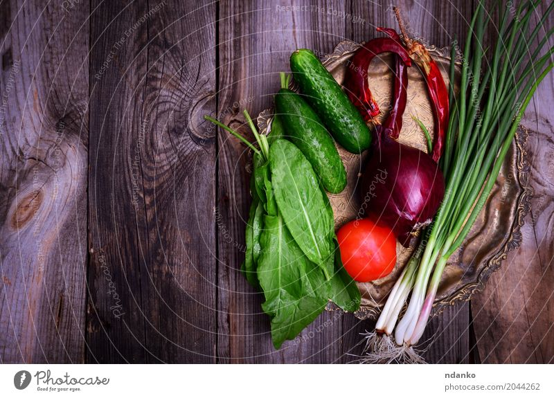 Fresh vegetables on an iron copper plate Food Vegetable Nutrition Vegetarian diet Diet Plate Table Kitchen Eating Natural Above Gray Green Red Tomato cucumber