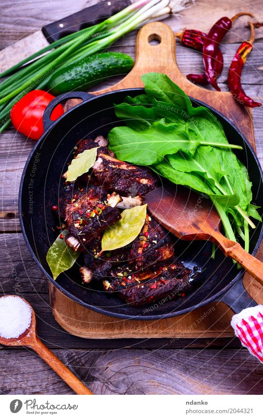 Cooked in spices pork ribs Meat Vegetable Herbs and spices Pan Wood Fresh Delicious Green Red Black Pork Ribs Grating Tomato Onion Edible Salad Top Spicy