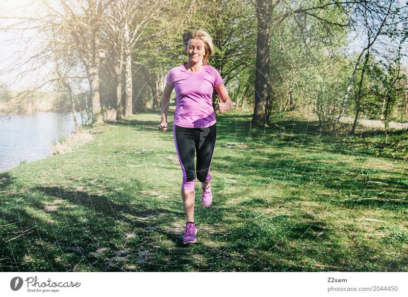 straight on Leisure and hobbies Sports Fitness Sports Training Jogging Young woman Youth (Young adults) Female senior Woman 60 years and older Senior citizen
