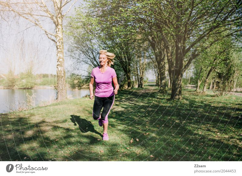 Woman Summer Beautiful Tree Landscape Lifestyle Senior citizen Meadow Healthy Sports Lake Pink Leisure and hobbies Blonde Power Idyll