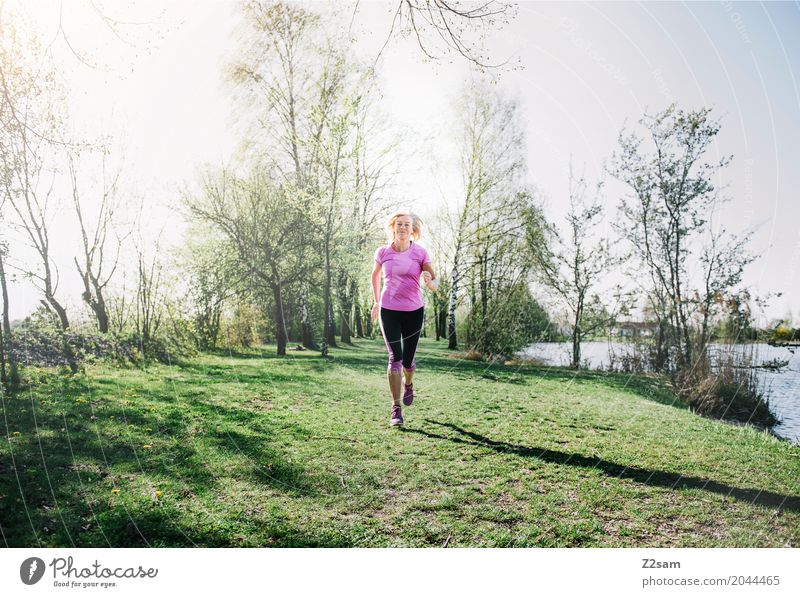 running Lifestyle Leisure and hobbies Sports Fitness Sports Training Jogging Woman Adults Female senior 60 years and older Senior citizen Landscape Sunlight
