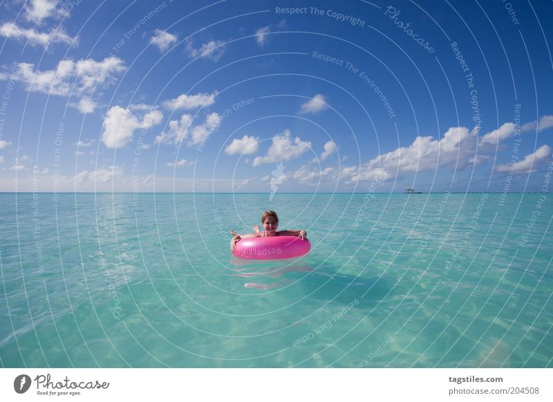 POINT PINK Pink Water wings Sky Turquoise Ocean Horizon Colour photo Copy Space top Copy Space bottom Woman Float in the water Leave Vacation & Travel