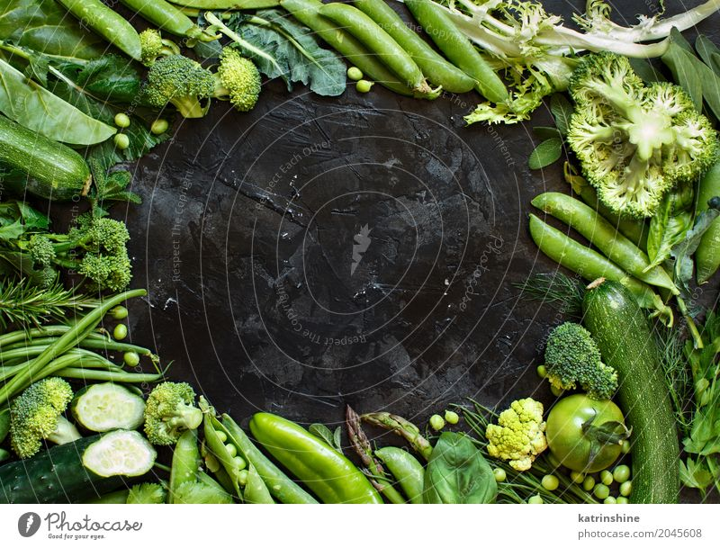 Mix of green vegetables on a dark table close up Vegetable Herbs and spices Diet Leaf Fresh Green agriculture Asparagus Beans bio Broccoli dieting Farm food