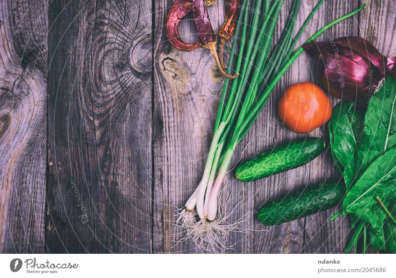 Fresh vegetables Food Vegetable Nutrition Vegetarian diet Diet Table Kitchen Natural Above Gray Green Red Tomato cucumber Onion lettuce pepper Organic healthy