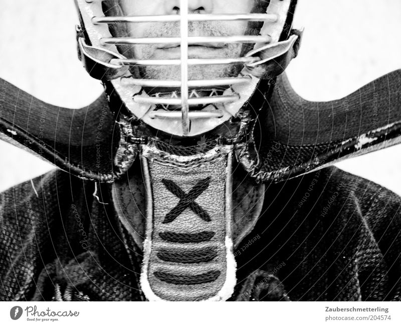 behind bars Martial arts Masculine Nose Mouth Lips Protective clothing Helmet Exceptional Threat Self-confident Unwavering Protection Black & white photo