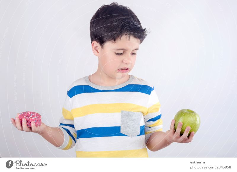 Little boy does not want to eat fruit Human being Child Healthy Eating Lifestyle Boy (child) Health care Food Fruit Nutrition Growth Infancy Sweet Candy Dessert