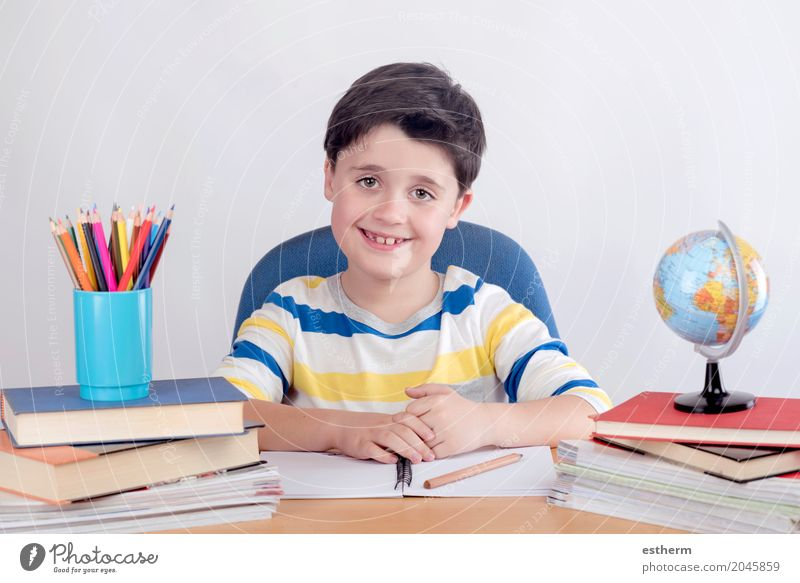 Smiling boy studying Human being Child Joy Lifestyle Boy (child) School Infancy Study Write Education Concentrate Student Toddler Kindergarten Self-confident