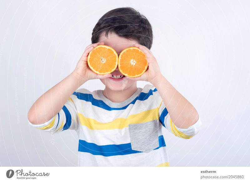 Funny boy with oranges Human being Child Joy Life Lifestyle Healthy Boy (child) Laughter Food Fruit Nutrition Fresh Orange Infancy Smiling To enjoy