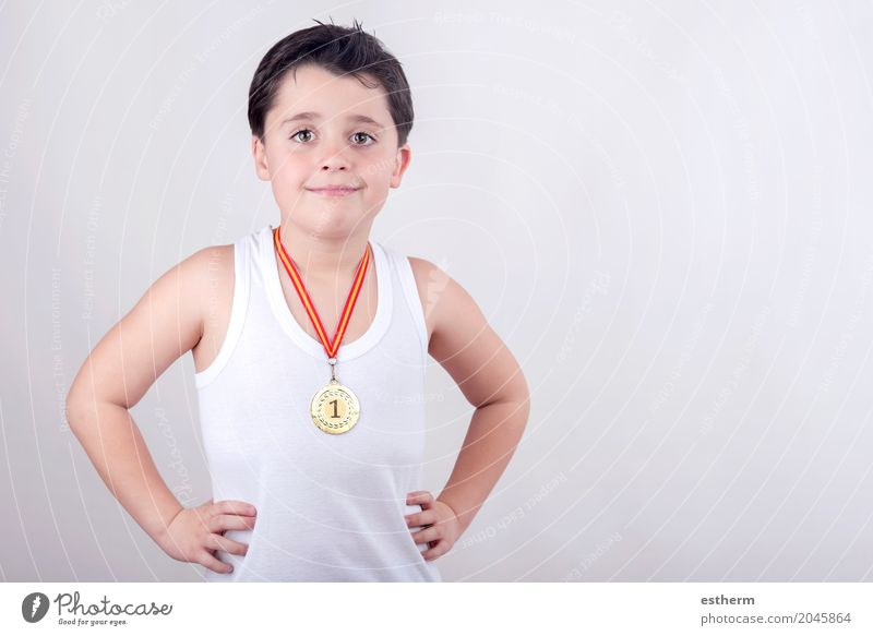 Happy little boy with golden medal Human being Child Joy Lifestyle Sports Boy (child) Playing Infancy Success Happiness Joie de vivre (Vitality) Fitness