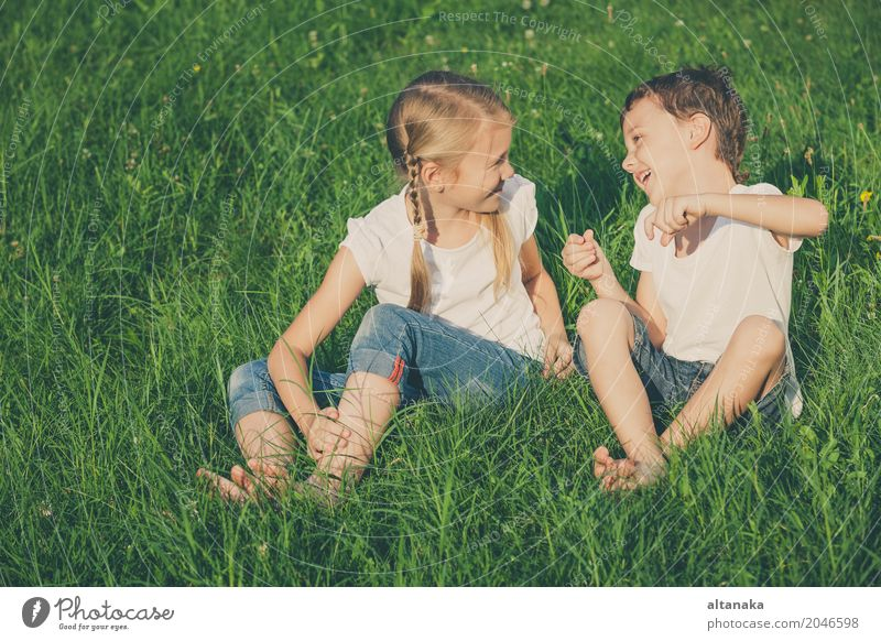 Two happy children playing near a tree on the grass Human being Child Nature Vacation & Travel Summer Beautiful Green Joy Face Lifestyle Love Meadow Grass