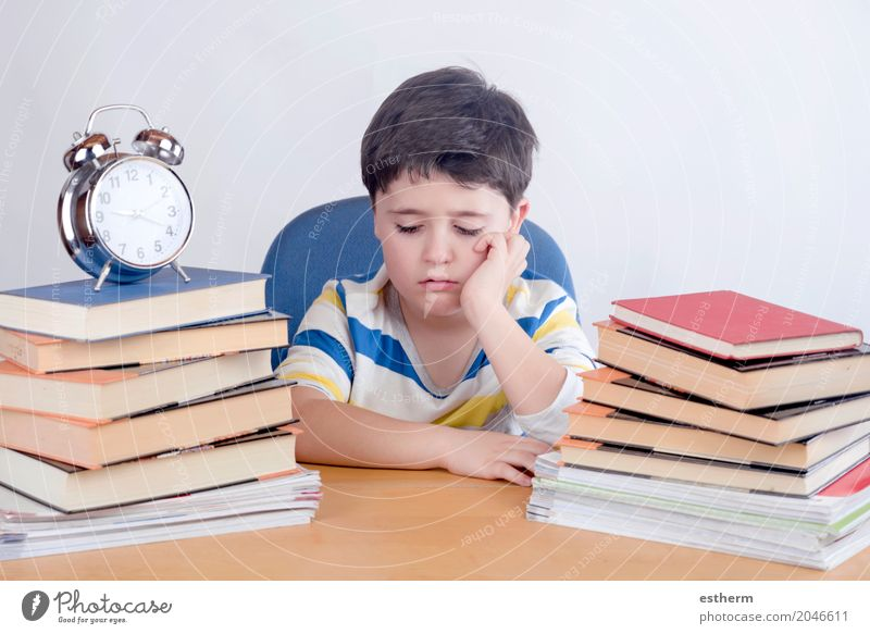 Boring schoolboy studying Human being Child Lifestyle Sadness Emotions Boy (child) School Think Moody Infancy Book Study Reading Curiosity Education Anger