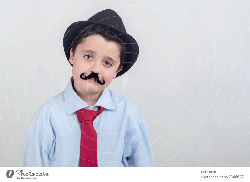Funny boy with fake mustache and tie Human being Child Adults Lifestyle Emotions Boy (child) Happy Party Feasts & Celebrations Together Work and employment Infancy Success Joie de vivre (Vitality) Education Profession
