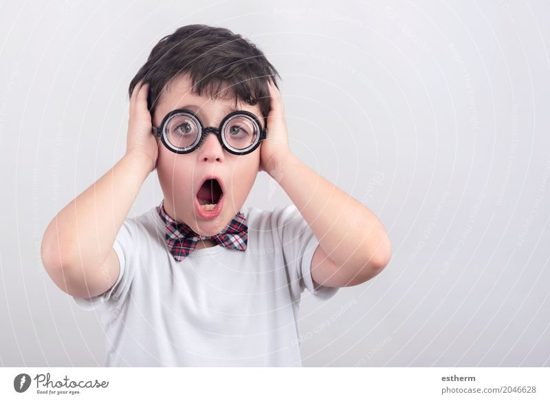Surprised boy with glasses Human being Child Lifestyle Emotions Boy (child) Party Moody Infancy Eyeglasses Carnival Toddler Shame Tie Nerviness Horror
