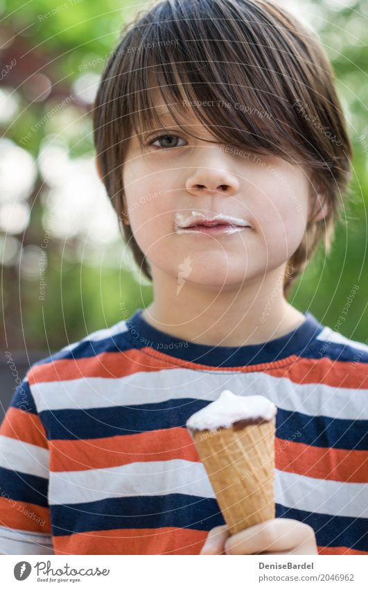 A boy with an ice-cream cone and a beard of ice-cream Food Ice cream Nutrition Picnic Shopping Happy Well-being Contentment Vacation & Travel Summer Sun