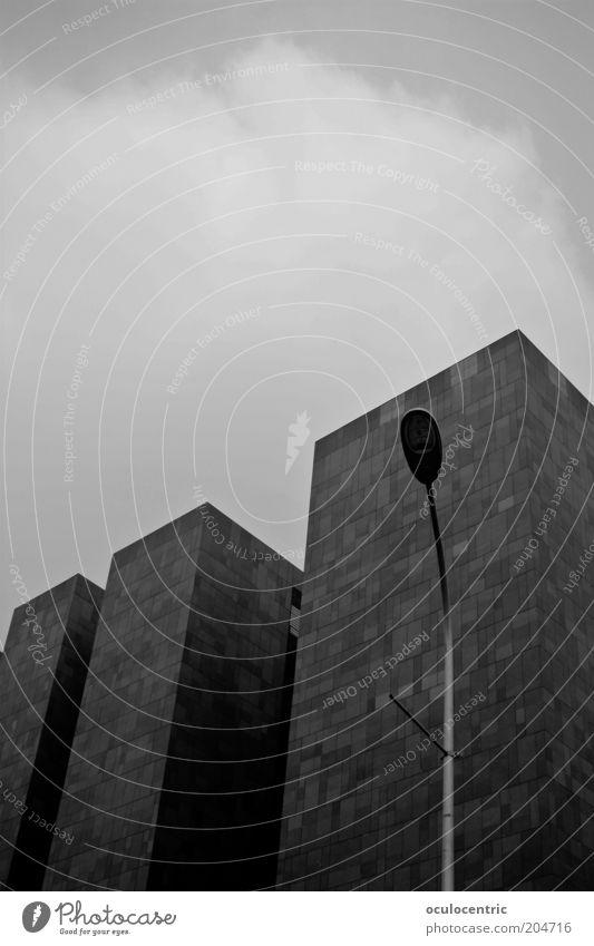 Calm Black Dark Gray Architecture Concrete High-rise Facade Modern Gloomy Simple Upward Street lighting Sharp-edged Monumental
