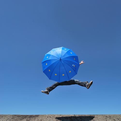 eu patronage Human being Man Adults Life Legs Feet 1 Umbrella Euro symbol Jump Europe European Europe emblem Europe Day Politics and state European flag Success