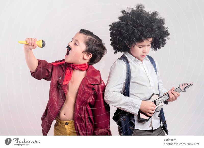 Children disguised as rock stars Human being Joy Lifestyle Boy (child) Party Together Friendship Leisure and hobbies Infancy Music Creativity Happiness Dance