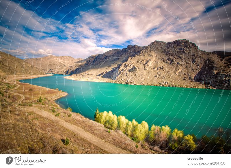 Nature Blue Mountain Lanes & trails Lake Landscape Environment Rock Esthetic Hill Elements Beautiful weather Wide angle Mountain lake Clouds in the sky