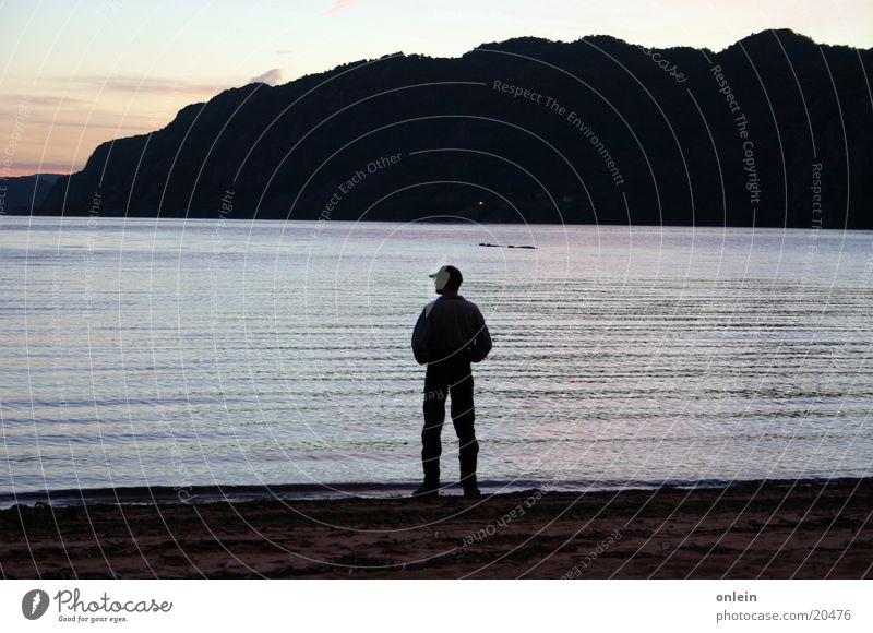 alone on the beach Man Beach Twilight Think Evening Fjord ponder Water Sand