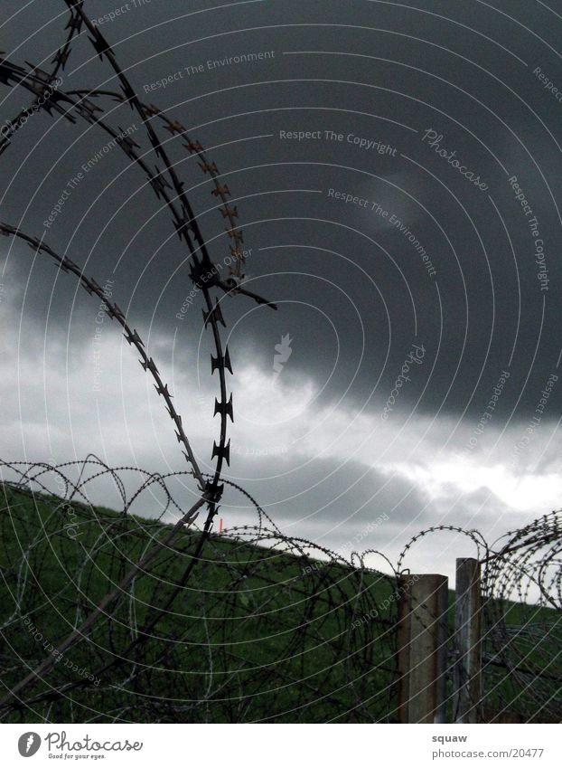 barbed wire Barbed wire Clouds dark sky Landscape