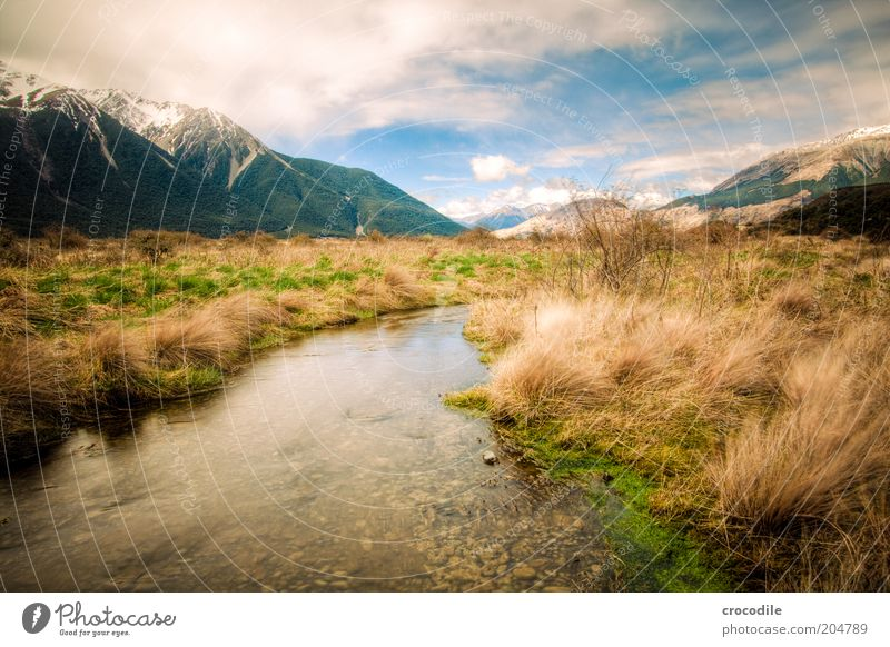 Sky Nature Water Vacation & Travel Calm Mountain Landscape Environment Island Elements Exceptional Alps Travel photography Peak Brook Grassland