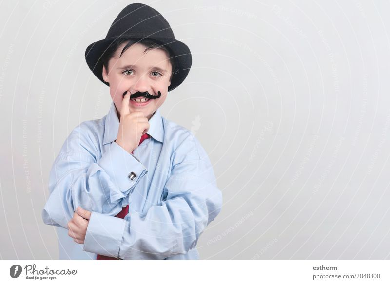 Funny boy with fake mustache and tie Lifestyle Party Event Feasts & Celebrations Mother's Day Carnival Parenting Education Child Work and employment Profession