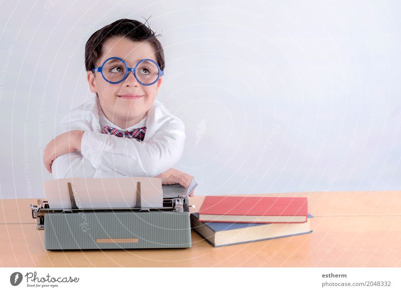 Smiling boy with typewriter Human being Child Calm Lifestyle Emotions Boy (child) School Infancy To enjoy Adventure Study Cool (slang) Curiosity Write Education