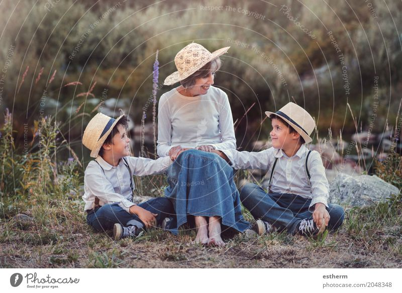 Grandmother with her grandchildren Human being Child Woman Nature Vacation & Travel Adults Life Lifestyle Love Senior citizen Emotions Meadow Boy (child)