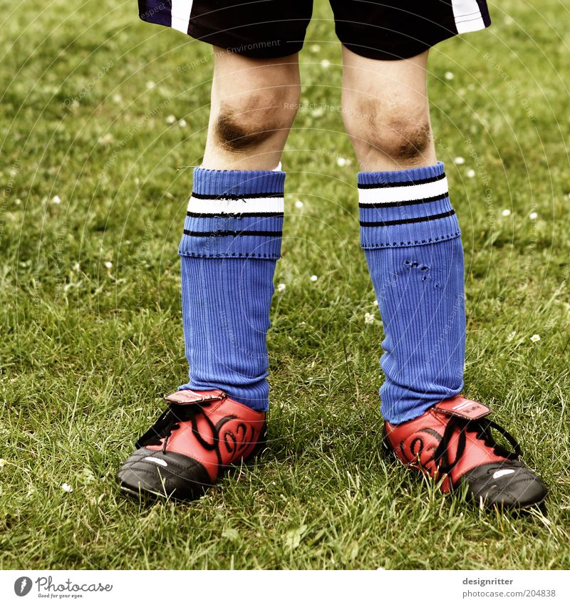 Child Blue Playing Boy (child) Sports Legs Leisure and hobbies Dirty Soccer Brave Passion Human being Sneakers Shorts Willpower Knee