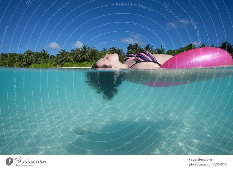 Woman Water Sky Summer Beach Vacation & Travel Clouds Relaxation Sand Adults Fresh Tourism Lie Swimming & Bathing Underwater photo