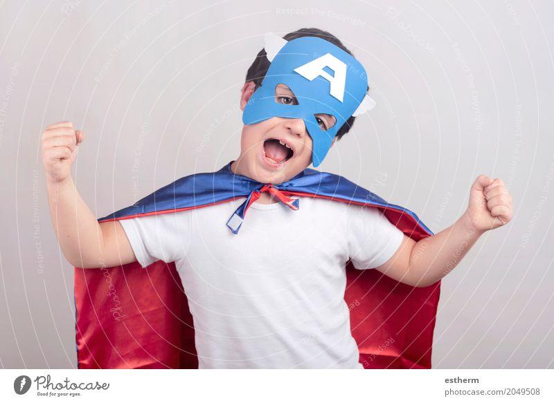 Child dressed as superhero Human being Joy Boy (child) Happy Power Infancy Happiness Adventure Good Strong Surprise Toddler Suitcase Euphoria Determination