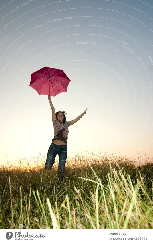 Pink Umbrella Joy Human being Young woman Youth (Young adults) Woman Adults 1 18 - 30 years Cloudless sky Spring Summer Grass Meadow Laughter Jump Free