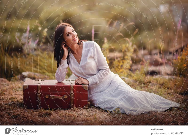 Woman sitting in the field with suitcase Human being Woman Vacation & Travel Youth (Young adults) Young woman Summer Beautiful Adults Lifestyle Spring Autumn Feminine Style Happy Freedom Trip