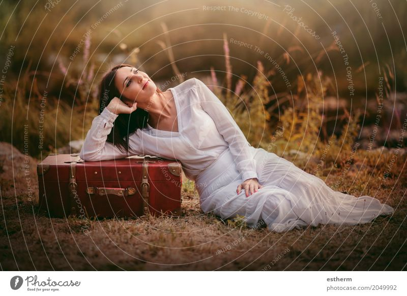 Woman sitting in the field with suitcase Lifestyle Elegant Style Beautiful Wellness Vacation & Travel Tourism Trip Adventure Freedom Human being Feminine
