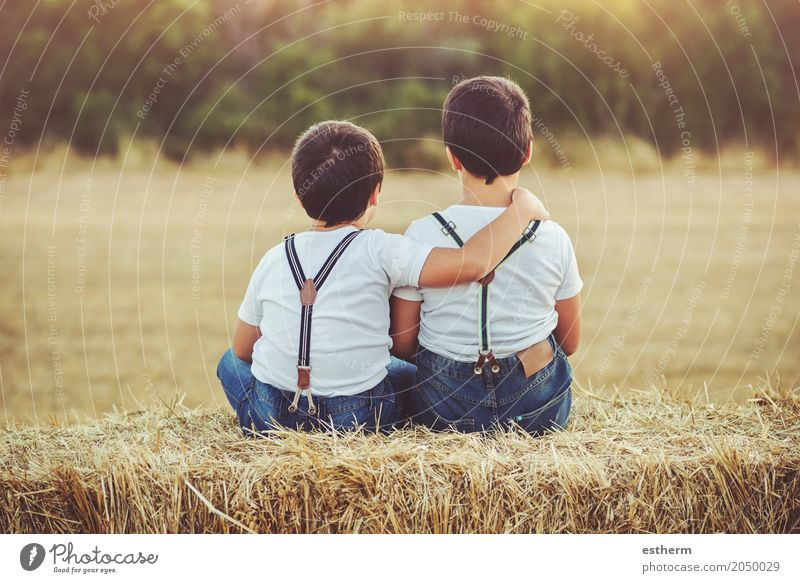 Brothers embraced sitting in the field Human being Child Joy Lifestyle Love Emotions Funny Boy (child) Family & Relations Together Friendship Infancy Sit