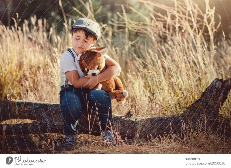 Boy hugging his teddy bear Human being Child Summer Joy Forest Lifestyle Spring Love Emotions Boy (child) Playing Together Friendship Masculine Infancy Happiness
