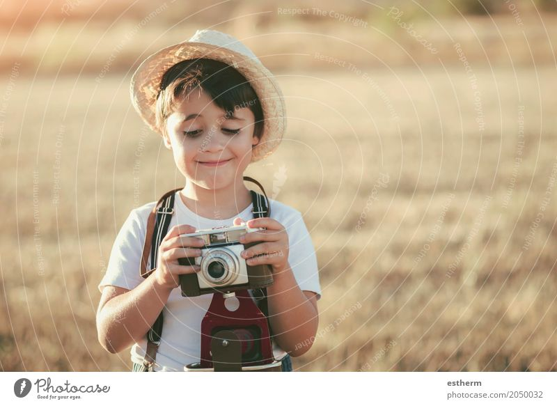 Happy boy with camera Human being Child Vacation & Travel Joy Lifestyle Emotions Meadow Boy (child) Laughter Freedom Masculine Trip Field Infancy Happiness