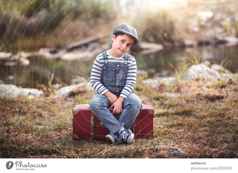 Pensive boy sitting in a suitcase Human being Child Nature Vacation & Travel Loneliness Lifestyle Love Emotions Boy (child) Freedom Masculine Trip Infancy Sit